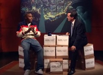 """Nas Brings Boxes and """"Sly Fox"""" To Colbert"""