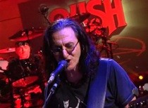 "Rush Sign Stephen Colbert's Hand, Perform ""Tom Sawyer"""