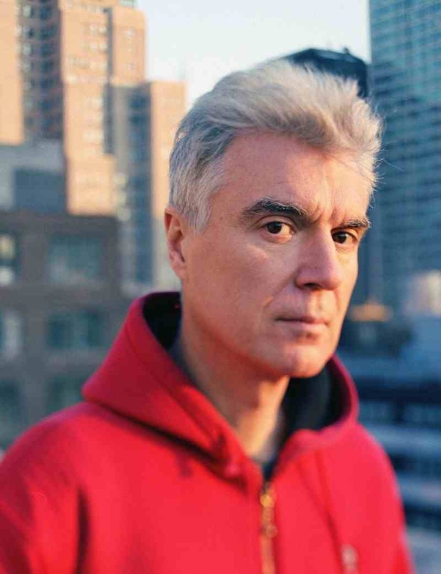 David Byrne in a red hoodie