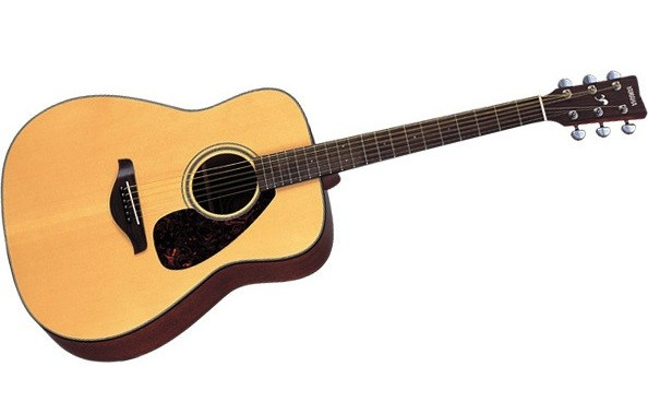 Win A Yamaha Acoustic Guitar & Graceland Collector's Edition