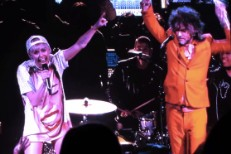 "Watch Miley Cyrus Cover ""Yoshimi"" With The Flaming Lips And Turn OutKast's ""Hey Ya!"" Into A Country Ballad"