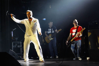 "Morrissey Returns To The Stage With Band In ""Fuck Harvest"" T-Shirts"