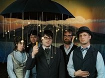 decemberists-raincoat_song_210x.jpg