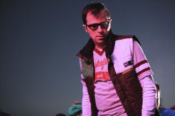 Rivers Cuomo in a Weezer Hurley vest
