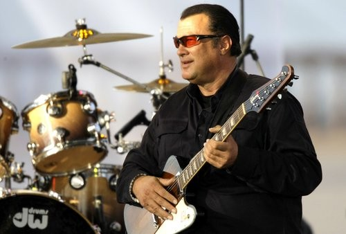 Actor Steven Seagal plays with his band in a charity concert organized by the Federation charity in Moscow, Russia, benefiting  children with cancer and eye disease