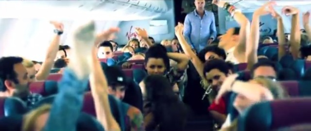Watch Kanye's Dancers' Flash Mob On A Plane