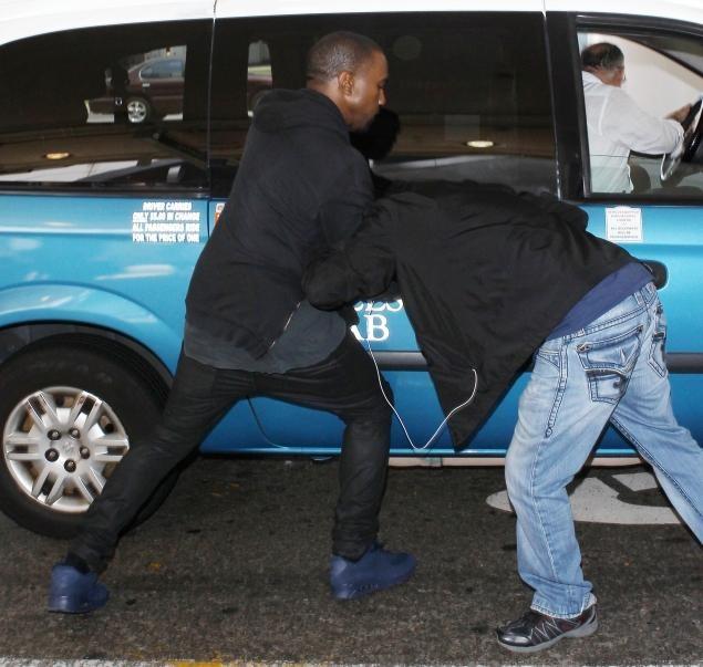 Kanye Attacks Paparazzi At LAX 7/19/13