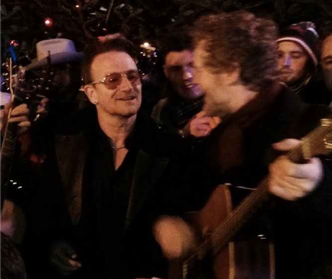 Bono & Glen Hansard Busk On Christmas Eve