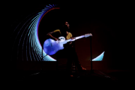 Kaki King Crowdfunding Audiovisual Performance Featuring Her Guitar As A Projection Screen