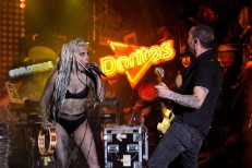 Watch Lady Gaga Get Doused In Neon Vomit While Riding A Mechanical S&M Pig At SXSW, Brought To You By Doritos