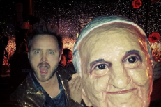 Aaron Paul with Arcade Fire's pope mask at Coachella 2014