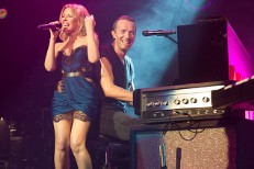 "Watch Kylie Minogue Join Coldplay For ""Where The Wild Roses Grow"" & ""Can't Get You Out Of My Head"" In Sydney"