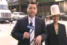 Erykah Badu Interrupts Live News Broadcast, Tries to Kiss Anchor