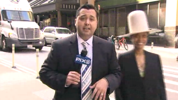 Erykah Badu Interrupts Live News Broadcast, Tries to Kiss Anchor