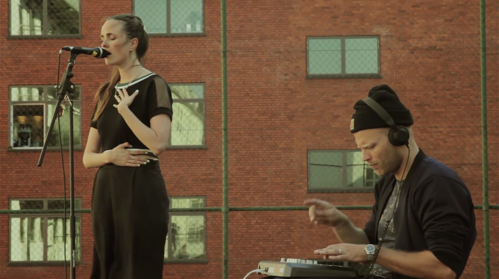 "Watch Tomas Barfod And Nina K Perform ""Busy Baby"" On A Copenhagen Tennis Court (Stereogum Premiere)"