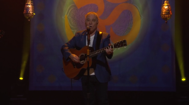 """Watch Paul Simon Cover """"Here Comes The Sun"""" And Remember George Harrison On Conan"""