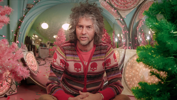 watch wayne coyne discuss the origin of christmas on mars in a clip from xmas doc