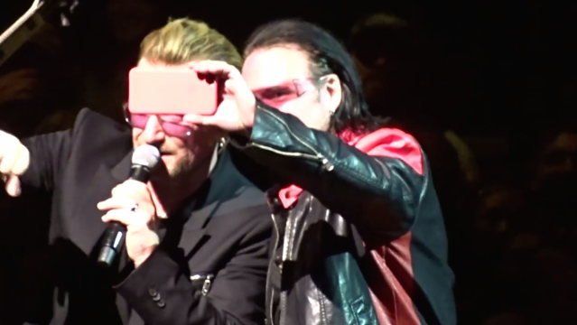 Bono Impersonator Gets To Sing Onstage With U2 And Won't Put His iPhone Down