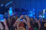 Watch Jon Hamm Feed Belle And Sebastian Gummy Bears Onstage At Bonnaroo