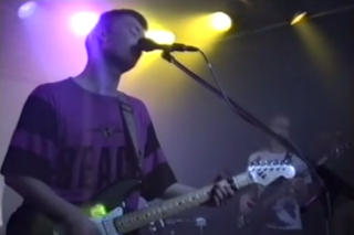 "Watch A Young Thom Yorke Perform ""High And Dry"" With His Pre-Radiohead Band Headless Chickens"