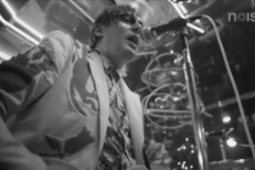 "Watch Arcade Fire Play Unreleased Song ""Get Right"" In Latest Reflektor Tapes Promo"