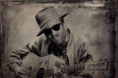 Watch The Black Keys' Dan Auerbach Invent A Blind Old Blues Guy In A Colbert Skit