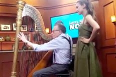 Watch Joanna Newsom Teach Larry King How To Play Harp