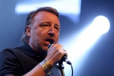 "New Order On Peter Hook: ""He Decided To Leave The House, And Now He's Outside It, Chucking Bricks Through The Window"""