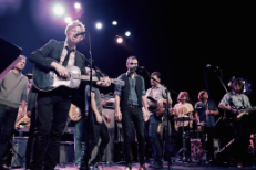 Watch Britt Daniel, Wayne Coyne, Brandon Flowers, & Weird Al Cover The Traveling Wilburys At George Fest