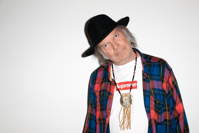 """Watch Neil Young Play """"Till The Morning Comes"""" For The First Time Ever At French Billionaire's Private Party"""
