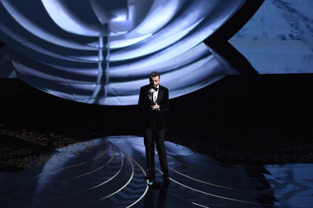 "Watch Sam Smith Sing ""Writing's On The Wall"" At The Oscars"