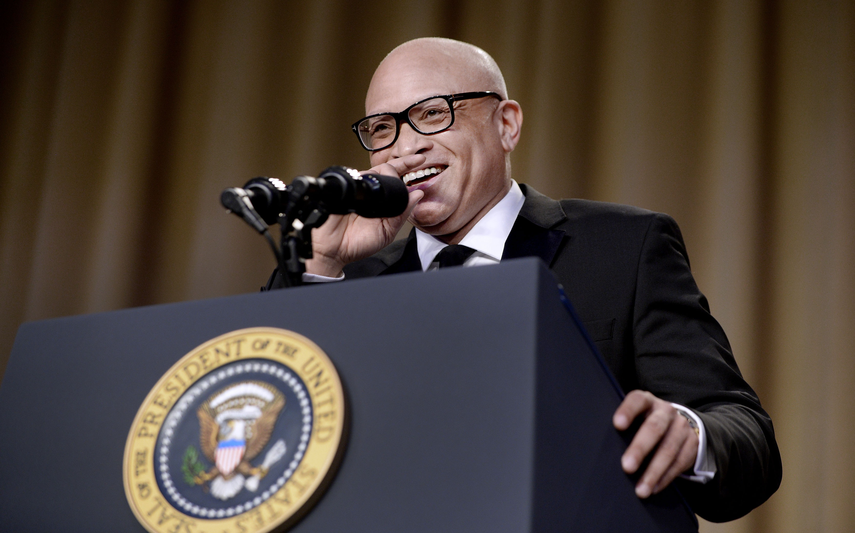 WASHINGTON, DC - APRIL 30: (AFP OUT) Comedian Larry Wilmore speaks during the White House Correspondents' Association annual dinner on April 30, 2016 at the Washington Hilton hotel in Washington.This is President Obama's eighth and final White House Correspondents' Association dinner (Photo by Olivier Douliery-Pool/Getty Images)