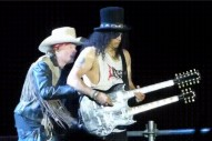"Watch Axl Rose Tickle Slash During ""Knockin' On Heaven's Door"" Guitar Solo"