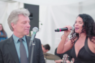 "Watch Poor Jon Bon Jovi Get Pressured To Sing ""Livin' On A Prayer"" With Wedding Band"