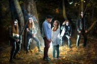 Couple Taking Engagement Photos Encounters Black Metal Band In The Woods