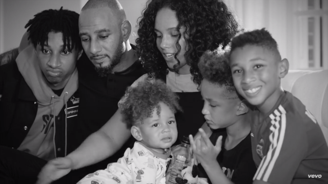 Family photo of the musician, married to Swizz Beatz,  famous for Fallin, New York with Jay-Z & Alvin.