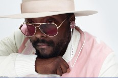 Will.i.am wearing i.am+ headphones