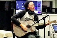 """Watch Chris Martin Cover George Michael's """"Last Christmas"""" In Surprise Performance At London Homeless Shelter"""