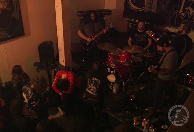 Watch A Guy Sleep Through An Entire Metal Show Happening Inches Away From Him