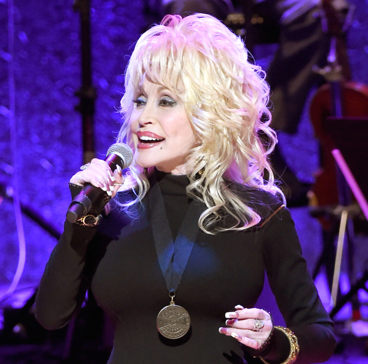 NASHVILLE, TN - OCTOBER 16:  Dolly Parton performs onstage during the 2016 Medallion Ceremony at Country Music Hall of Fame and Museum on October 16, 2016 in Nashville, Tennessee.  (Photo by Rick Diamond/Getty Images for Country Music Hall of Fame & Museum)