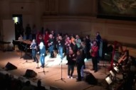 "Watch Patti Smith, Sufjan Stevens, Iggy Pop, Philip Glass, Laurie Anderson, New Order, Alabama Shakes, Ben Harper, & Tibetan Monks Sing ""People Have The Power"" At Carnegie Hall"