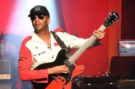 "Hear Tom Morello's New Song ""Keep Going"" On A Podcast Featuring Julian Assange"