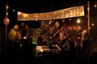 Watch R.E.M.'s Peter Buck Read A Book At His Birthday Party In New Eyelids Video