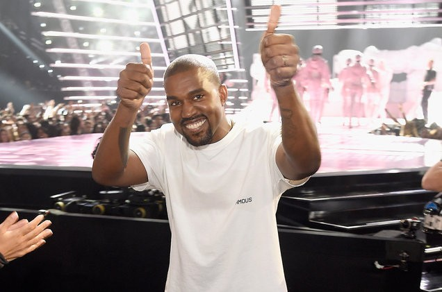 kanye-west-thumbs-up-mtv-vmas-red-carpet-2016-billboard-1548-1491340469