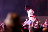 Travis Scott Claims He's Not Responsible For Fans Who Jumped From Third Story Concert Balcony