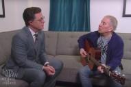 "Watch Paul Simon & Stephen Colbert Update ""Feelin' Groovy"" For A Terrifying Age"