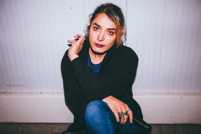Q&A: Warpaint's Jenny Lee Lindberg On Playing The Festival Circuit, Touring With Harry Styles, & Superfan Ellen DeGeneres