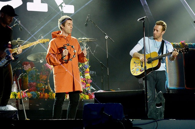 Liam-Gallagher-and-Chris-Martin-of-Coldplay-perform-on-stage-during-the-One-Love-Manchester-Benefit-Concert-2017-billboard-1548-1501078724