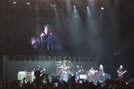 "Watch Foo Fighters & Rick Astley Play A Grunge ""Never Gonna Give Up"" In Japan"