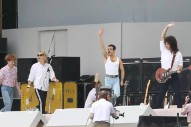 "Watch Rami Malek As Freddie Mercury Play ""Bohemian Rhapsody"" For Queen Biopic's Live Aid Scene"